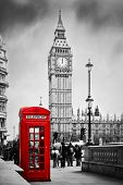 Red telephone booth and Big Ben in London, England, the UK. People walking in rush. The symbols of London in black on white.