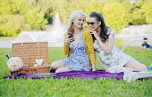 Smiling women relaxing in the park