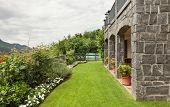stone house, porch, garden view