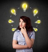 Thoughtful young woman with shining lightbulbs circulating around her head