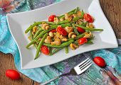 Green beans with mushrooms and tomatoes
