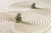 A japanese zen garden with stacked pebbles
