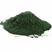 Spirulina powder algae nutritional supplement heap surface close up top view, isolated on white back