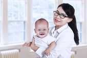 Asian Businesswoman And Her Baby