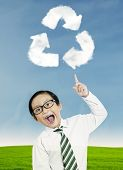 Child Pointing At Recycle Symbol