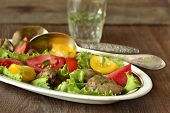 Salad with chicken liver and tomatoes