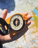 Compass Under The Sun On The Palm