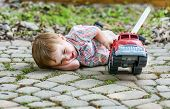 Toddler Playing With A Toy Fire Truck Outside - Series 6
