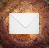 Envelope on wood, concept of communication