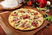 White Pizza made from Sour Cream Sauce, Mushrooms, Bacon and Mozzarella Cheese