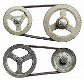 Old metal pulleys with belt.