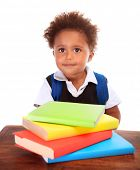 Portrait of cute little boy wearing school uniform with many colorful books isolated on white backgr
