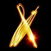 X - Created by light alphabet over black background