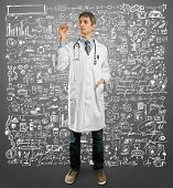 Doctor male writing something with marker on glass