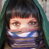 Close-up portrait of a girl with a veiled face.