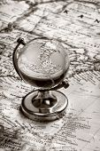 globe glass on old map