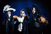foto of warlock  - Cheerful children in halloween costumes standing with pumpkins - JPG
