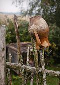 Old crock on picket fence