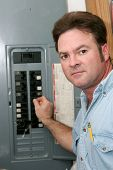 Electrician At Breaker Panel