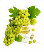 White Wine In A Glass With A Large Brush Of Green Grapes
