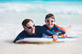 picture of boogie board  - Father and son on vacation having fun surfing on boogie board - JPG