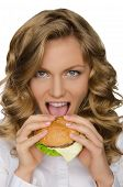 Beautiful Young Woman Taking Bite Of Hamburger