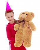Girl in Winter Hat holding a teddy bear.