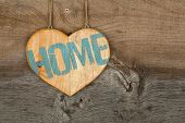 Love Home Message Wooden Heart Sign On Rough Grey Wooden Background