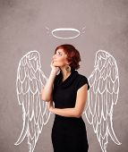 Cute girl with angel illustrated wings on grungy background
