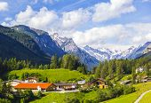 Alpine village under Innsbruck in the green valley among the mountains