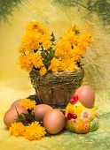 Easter Concept. Eggs And Spring Flowers With A Figure Of A Chicken