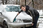 Driver With Brush Cleans Car From Snow