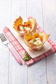 little lasagne on glass bowl