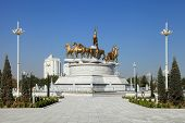 Ashgabat, Turkmenistan - October, 10 2014: Sculptural Composition To Fast Horses In The Park. Ashkha