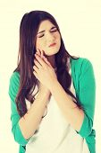 Beautiful young woman having toothache.