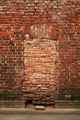 Texture Of Red Brick Wall With Traces Of Windows