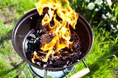 stock photo of charcoal  - Hot burning charcoal grill on fire - JPG
