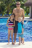 Family enjoying the pool at a tropical resort
