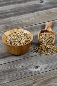 Traditional Mixed Grain Rice With Kitchenware On Rustic Wood
