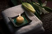 Aromatic candle and flowers - a spa set up