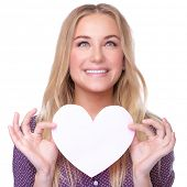 Closeup portrait of beautiful blond girl holding in hands paper heart isolated on white background, healthy lifestyle or Valentine day celebration