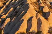 Detailed photo of vivid rock formations shaped by a morning light - seen from above in Cappadocia, Turkey