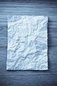 wrinkled paper  on wooden background