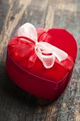 red love heart gift box on wooden background