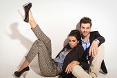 foto of legs air  - Beautiful young woman sitting and leaning on her boyfriend while holding one leg in the air - JPG