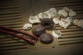 stock photo of black tea  - Black compressed tea with Chrysanthemum tea on a tea tray - JPG