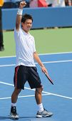 Professional tennis player Kei Nishikori celebrates victory after first round US Open 2014 match