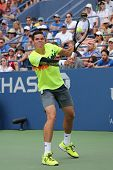 Professional tennis player Miols Raonic from Canada during third round match at US Open 2014