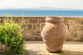Ancient Terracotta Vase Against A Mediterranean Panorama