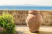 Ancient Terracotta Vase Against A Mediterranean Panorama